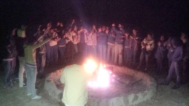Kids praising at fire